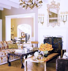 Tour the Ultimate Designer Dream Home// double coffee tables, eclectic home, patterned sofa, carved gilt mirror