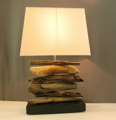 Unique driftwood lamp with modern rectangular lampshade, stacked drift wood lamp. $60.00, via Etsy.