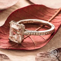 A Tacori beauty from the Tacori Classic Crescent collection with an emerald cut center stone and diamond encrusted band.  Style no. HT2553EC85X65 Available at BENARI JEWELERS.