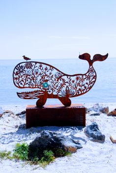 Whale sculpture by the sea