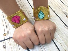 These bracelets are made of glitter vinyl and soft acrylic felt. Your choice of a single set (two bands) or a set of both (four bands). Want more to go with your bracelets? Check out the masks I have to match: