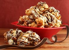 Fancy Caramel Popcorn- this sounds yummy!  Must try without the microwave and substituting honey for corn syrup.