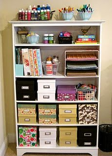 Photo boxes for storage. Organize photos by year with cute labels on each box. Living room shelf.....