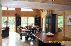 Log Cabin Great Room, Interior of our recently built log cabin., View from kitchen into great room of log home, Living Rooms Design