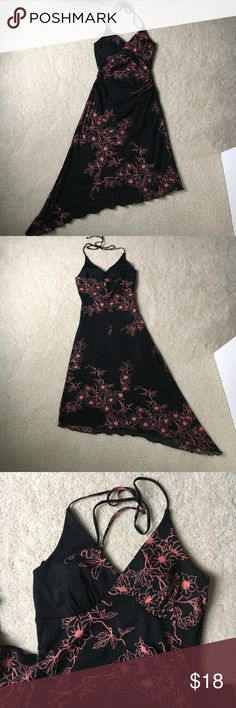 Charlotte Russe asymmetrical halter dress Super fun and cute Charlotte Russe asymmetrical halter dress in brand new condition never worn. Dress is lined and is 100% polyester. Slight built in padding on bust. Charlotte Russe Dresses Asymmetrical