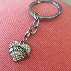 Nurse key chain.  NWOT    A 2/$15 SALE ITEM  Heart is about half an inch in size. Accessories Key & Card Holders