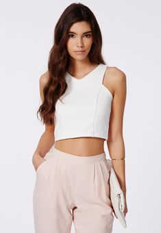 90's crop tops are en vogue. Style w a pencil skirt for a chic look.