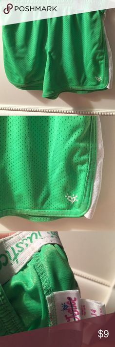 NWOT neon green running shorts These neon green running shorts from justice size 14 is xs! Has mesh details and justice on the waistband on the inside! Super cute! Justice Shorts
