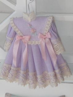 Dollhouse lavender girl dress on hang. 1:12 dollhouse miniature dress on hang.