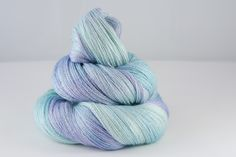 Clarens Lace  55% Bluefaced Leicester, 45% Silk  Lace, 100g skeins, 800 metres per 100g  Colour - variegated pale mint, lavender, sky blue, hyacinth  Hand-wash recommended, dry flat