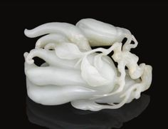 A Pale Celadon Jade carving of a finger citron. Qing dynasty, Qianlong period