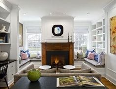 Library - awesome built-ins around fireplace (window seats, bookcases, desk)