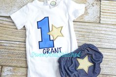 Customized and Personalized Baby boy Star birthday shirt or tee with Number and star design shown in blue and gold. Goes with Star Birthday theme!  Denim diaper cover available as an add on with a gold star embroidered on the rear in the coordinating fabric. **Bloomers are one size for FIRST BIRTHDAYS ONLY. This listing uses Blanks Boutique Bodysuits for first birthdays in size 12M (slightly longer than Carters brand 12M) or 18M. These Bodysuits are high quality boutique style bodysuits and…