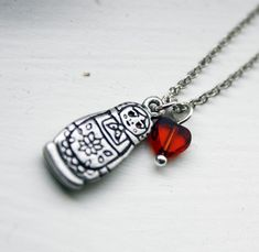 Russian nesting doll necklace #silver #red