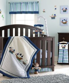 Inspire happily ever after dreams with this fanciful pirate nursery set. Complete with a blanket, crib sheet, dust ruffle and diaper stacker, it makes decorating a breeze.Includes blanket, dust ruffle, crib sheet and diaper stackerBlanket: 35'' x 45''Dust ruffle: 25'' W x 52'' H x 14'' D