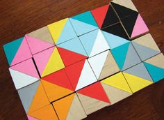 A fantastic and low-cost DIY project! Paint blocks with triangles and have fun making mosaic pictures. A great way for little ones to learn about colors and shapes also.