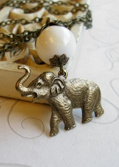 Elephant necklace brass charm white glass beads
