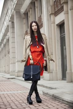 Stylist Li Hui with the Tommy Ton for Club Monaco messenger bag.