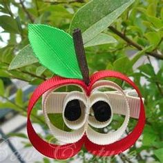 totally cute ~ made from ribbon, but I'll do with heavy paper or cardboard, pipe cleaner, pom-pom