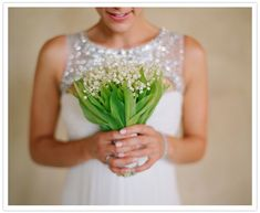 Such a sweet wedding bouquet...I love how it complements the bride's sparkly #wedding dress! From http://100layercake.com/blog/2013/01/03/pacific-palisades-wedding-saree-sidh/ Photo Credit: http://elizabethmessina.com/  Florals by http://thevelvetgarden.com/