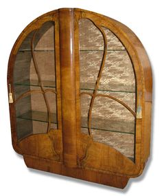 Beautiful and original 1930's Art deco walnut display cabinet. A lovely piece of furniture that's veneered in figured mid tone walnut. Still retains its original silk interior backing with a Deco pattern. Two original keys which work smoothly to both doors. There are three internal glass shelves