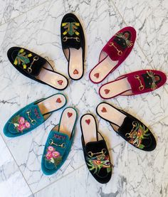 We love these unique loafers from Gucci. Our favorite is the velvet mule with embroidered angry panther cat patch