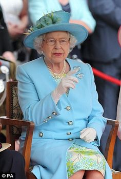 6/25/2012: Queen Elizabeth II watches a flotilla of boats celebrating the history of the River Thames (Henley-on-Thames, Oxfordshire)