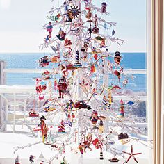 A Collector's Christmas   -   Show off your collections while still adding some holiday cheer to your home! Using a wire twig tree, turn small collectibles into festive ornaments with inexpensive fishing hooks or wire. Thin gold chains also look great when paired with strings of twinkle lights.