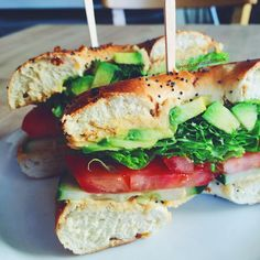 Veggie bagel at my favorite café in San Luis Obispo  I got it loaded with hummus, lettuce, tomato and cucumber. Sooo satisfying!  I'm definitely going to make something like this at home  ✨✨✨