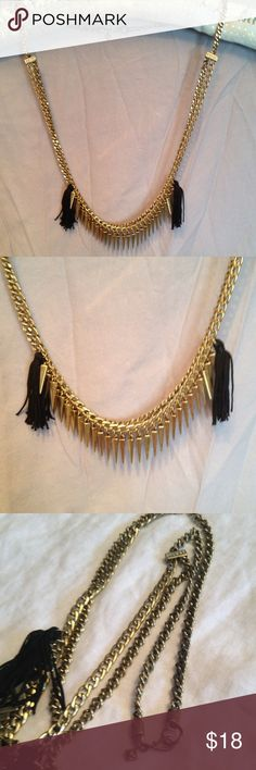 """Rebecca Minkoff Layered Necklace with Tassels Rebecca Minkoff double chain antiqued gold necklace gives any outfit a trendy edge. Black cloth tassels, 2"""" in length and pyramid shaped dangles adorn one layer. The second chain is plain but joined to the other chain by 2 rhinestone enhanced links.  Length of necklace is 16"""". Hang tag has rhinestone and inscribed RM.  Excellent condition. Rebecca Minkoff Jewelry Necklaces"""