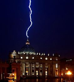 Lighting Strikes The Basilica Of St.Peter's Dome After Pope Resignation