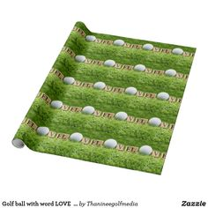 Golf ball with word LOVE are on green grass Wrapping Paper