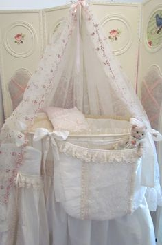Shabby Chic/ cute little bag at the end of the crib.