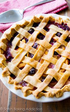 A classic lattice-topped homemade blueberry peach pie bursting with juicy flavor. You will love this pie crust too! @Sally [Sally's Baking Addiction]