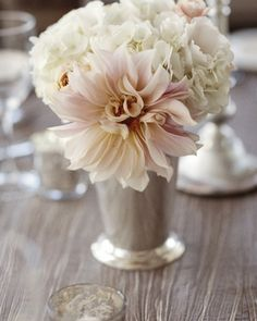 a dreamy centerpiece in shades of blush and cream.