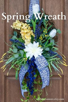 his spring grapevine wreath is packed with florals perfect for your spring and summer decor. A cone hydrangea, tulips, a dahlia, wildflowers and gorgeous greenery topped off by gorgeous blue and white ribbon make this floral wreath the perfect addition to your home decor. Spring Door Wreaths, Deco Mesh Wreaths, Summer Wreath, Wreaths For Front Door, Yellow Springs, How To Make Ribbon, White Ribbon, Wildflowers, Grapevine Wreath
