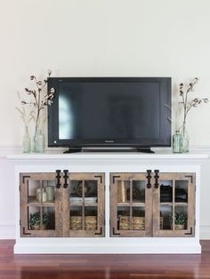 Are you looking for DIY TV Stand ideas? Why you not to try our list of simple DIY project that will cost you under 100 bucks.These free DIY TV stand project. Build A Tv Stand, Tv Stand Plans, Diy Tv Stand, How To Decorate Tv Stand, Tv Stand Makeover, Farmhouse Media Cabinets, Rustic Cabinets, Rustic Shelves, White Cabinets