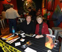 "Book signing with Susan Van Kirk's (right) ""Three May Keep a Secret""."