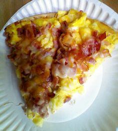 Breakfast pizza. Yummm! Pizza crust, melted velvetta cheese for sauce, 12 eggs scrambled, precooked bacon, diced ham, onion and shredded cheese for the top. Prepare your pizza and bake at 350 for 15 - 20 minutes and then enjoy.