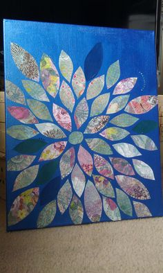 Painted canvas with acrylic paint. Cut leaf/petal designs from scrapbook paper and mod podged to painted canvas. Added small colored rhinestones for accents....I WILL BE DOING THIS