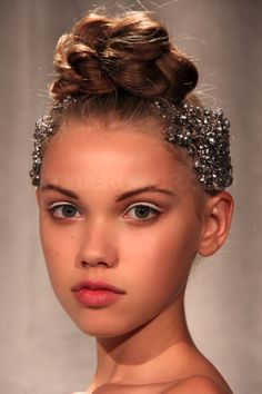 Granted...she looks like she's 14 yrs. old... but I'm really intrigued by this hair style.