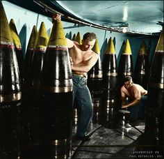 "Ordnance men moving a 16"" shell from its storage stall to ammunition hoist on board the Iowa Class Battleship USS New Jersey (BB-62). Nov 1944. 16""/50 calibre Mark 7 gun"
