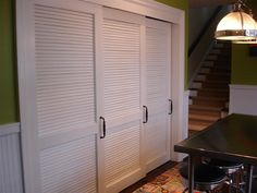 White Sliding Louvered Doors for hallway cupboard minus handles.