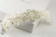 This elegant bracelet cuff for the bride on her very special day embodies a beautiful lace work and hand sewn rhinestones, pearls and glass beads. The bracelet is 1.5 inches wide and has a closing end of a silver plated hook and a ring and can be custom made for your size.