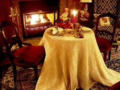 Romantic table for two beside the fire