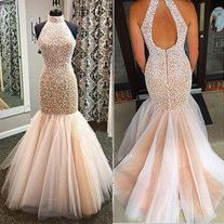 Length:Floor-Length Sleeve:Sleeveless Neck:Halter Back:Zipper Fabric:Tulle Decorate:Pearled Shape:Mermaid Color:As Picture Color or Custom Made Color Size:Standard Size or Custom Made Size The setting of computer screen or photo capturing may alter the real color of the dress shown on ou...