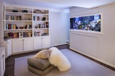 A built-in #aquarium is an unexpected delight in a lower level landing and huge pillows offer perfect viewing perches.  #INTERIOR #DESIGN: A. Houck Designs, Inc.