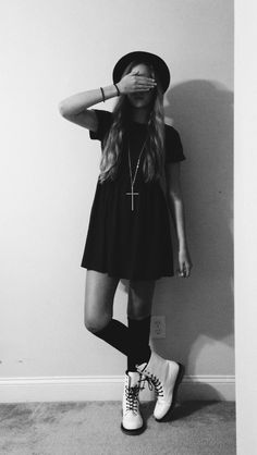 Grunge fashion back and white cross street style dress.