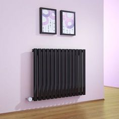 Radiator Hut, the UK's leading provider of designer radiators, offers an extensive selection of horizontal radiators that are sure to add elegance and timeless grandeur to interiors of commercial and residential spaces. Front Room, Interior, Radiators Modern, Home, Modern, Heat Installation, Vertical, Apartment Inspiration, Vertical Radiators
