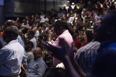 Members of the crowd listen to a speaker at an anti-racism meeting attended by Toronto Mayor John Tory and Ontario Premier Kathleen Wynne in Toronto on Thursday July 14, 2016. THE CANADIAN PRESS/Chris Young